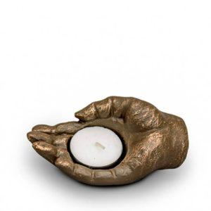 keramische tierurne liegende hand waxine